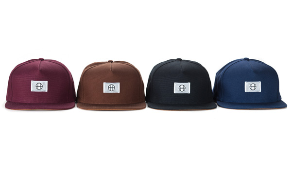 1111huf_holiday11_dashed_circle_h_snapback_groupshot.jpg