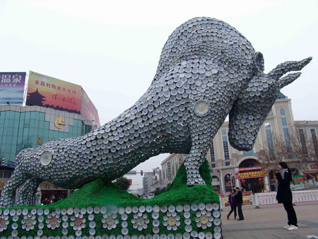 A-giant-statue-of-the-ox-made-up-of-porcelain-dishes-and-cups.jpg
